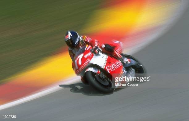 Alberto Puig of Spain leans into a corner on his Honda during the Malaysian Grand Prix at the Shah Alam circuit in Malaysia Mandatory Credit Mike...