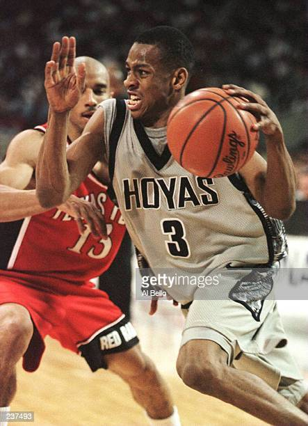 Allen Iverson of Georgetown drives around Jason Martin of Texas Tech in the first half of the NCAA East Regional Men''s Basketball game played at the...