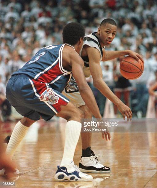 Allen Iverson of Georgetown University looks for room to move past John Celestand of Villanova University during their Big East Season finale at the...