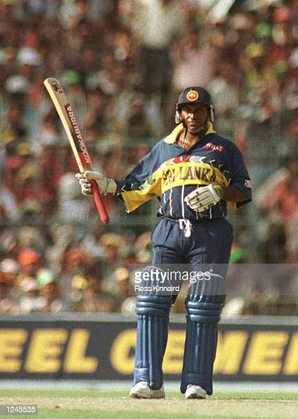 Aravinda De Silva of Sri Lanka salutes the crowd after reaching his half century during the semifinal of the Cricket World Cup between India and Sri...