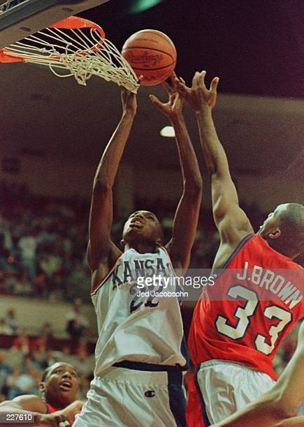 BJ Williams of the Kansas Jayhawks fights for a rebound with Jamal Brown of the South Carolina State Bulldogs during the first round of the NCAA...