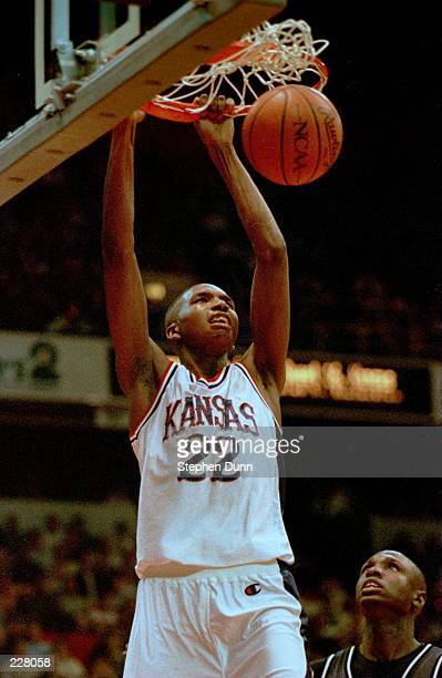 BJ Williams of the Kansas Jayhawks slam dunks during the Jayhawks NCAA tournament game versus the Arizona Wildcats in the NCAA West Regionals at...