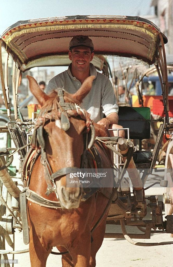 Captain Hansie Cronje of South Africa enjoys a ride in a horsecart through the streets of downtown Rawalpindi Pakistan South Africa are to play...
