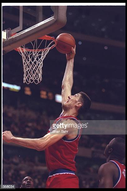 Center Gheorghe Muresan of the Washington Bullets goes up for two during a game against the Chicago Bulls at the United Center in Chicago, Illinois....