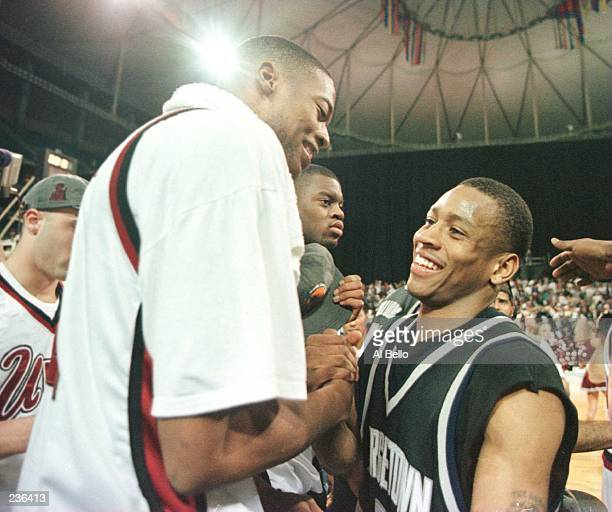 Center Marcus Camby of the UMass Minutemen shakes hands with point guard Allen Iverson of the Georgetown Hoyas following the Minutemen''s 8662 NCAA...