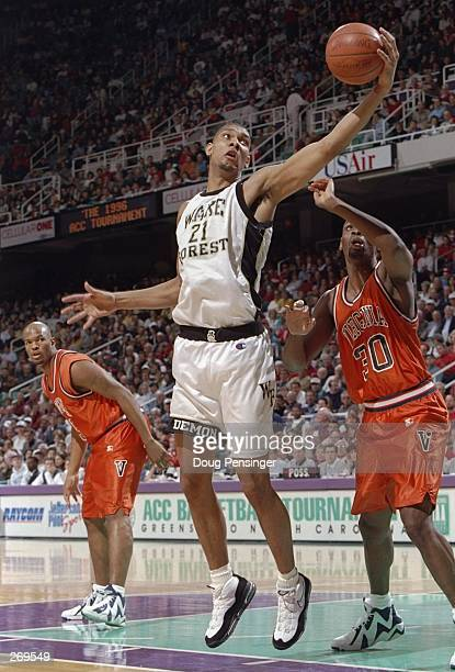 Center Tim Duncan of the Wake Forest Demon Deacons moves the ball during a game against the Virginia Cavaliers at Greensboro College in North...