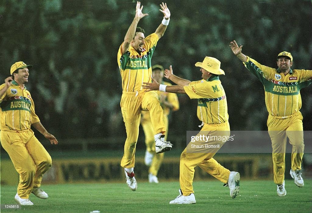 Damien Flemming of Australia celebrates taking the final wicket of Courtney Walsh during the Semi Final match between Australia and West Indies...