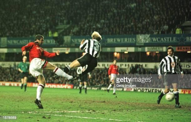 Eric Cantona scores the opening goal for Man Utd during the Newcastle Utd v Manchester Utd FA Premiership match at SJames Park Newcastle Please...