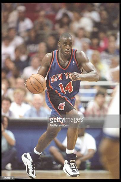 Forward Anthony Mason of the New York Knicks dribbles down the court during a game against the Orlando Magic at the Orlando Arena in Orlando,...