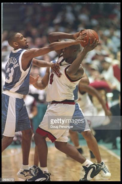 Forward Donta Bright of the Massachusetts Minutemen tries to fend off guard Derek Anderson of the Kentucky Wildcats during a playoff game at the...