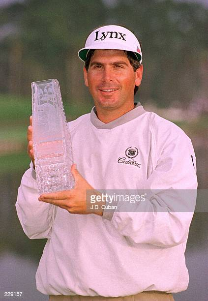 Fred Couples of the USA holds the winner''s trophy after the final round of the 1996 Players Championship at the TPC at Sawgrass Stadium Course in...