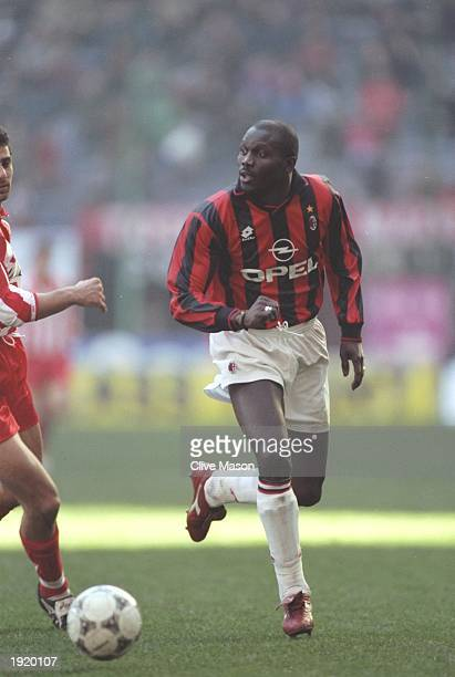 George Weah of AC Milan in action during a Serie A match against Vicenza at the Guiseppe Meazza Stadium in Milan Italy Mandatory Credit Clive...