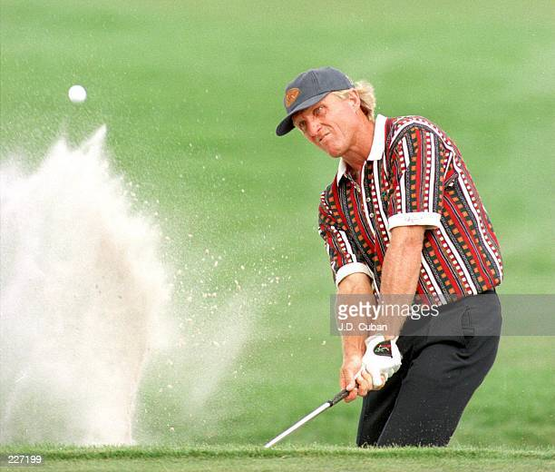 Greg Norman hits his third shot on the ninth hole during the first round of the 1996 Honda Classic at TPC Eagle Trace in Coral Springs Florida Norman...