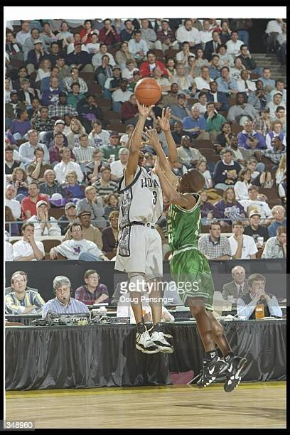 Guard Allen Iverson of the Georgetown Hoyas and Mississippi Valley State Delta Devils player Chris Smith go up for the ball during a game at the...