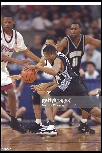 Guard Allen Iverson of the Georgetown Hoyas moves the ball during a game against the Massachusetts Minutemen at the Georgia Dome in Atlanta Georgia...