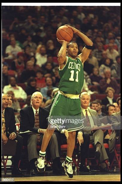 Guard Dana Barros of the Boston Celtics prepares to shoot the ball during a game against the Chicago Bulls at the United Center in Chicago Illinois...