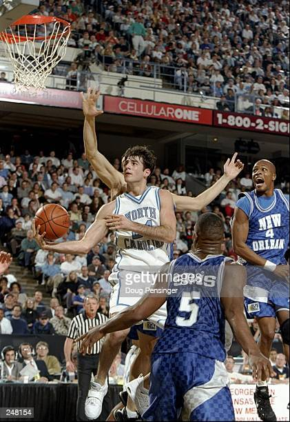 Guard Dante Calabria of the North Carolina Tarheels drives to the basket during a playoff game against the New Orleans Privateers at the Richmond...