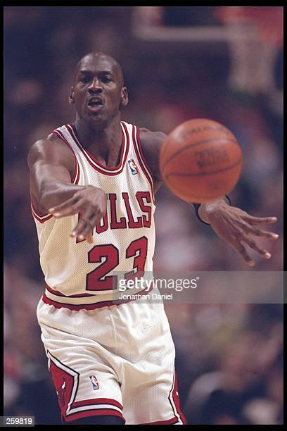 Guard Michael Jordan of the Chicago Bulls passes the ball during a game against the Sacramento Kings at the United Center in Chicago, Illinois. The...