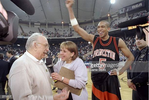 Guard Sydney Johnson and coach Pete Carril of the Princeton Tigers celebrate after a game against the UCLA Bruins at the RCA Dome in Indianapolis...