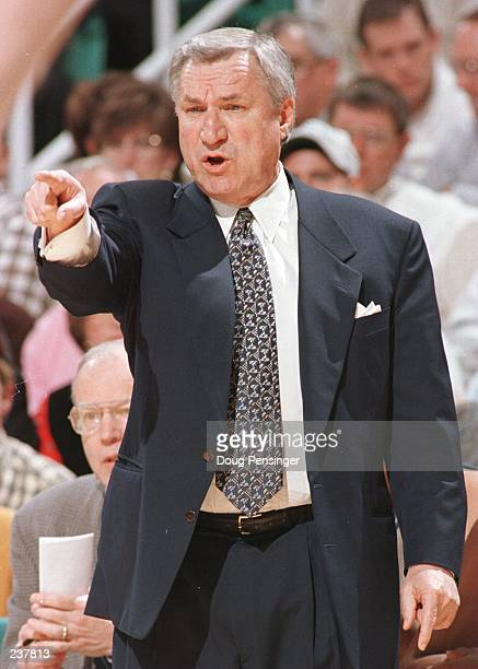 Head coach Dean Smith of the North Carolina Tar Heels shouts instructions from the sideline during the Tar Heels ACC Quarterfinal game against the...