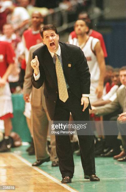 Head coach John Calipari of the UMass Minutemen shouts instructions to his team from the sideline during the Minutemen''s 81-74 NCAA Final Four...