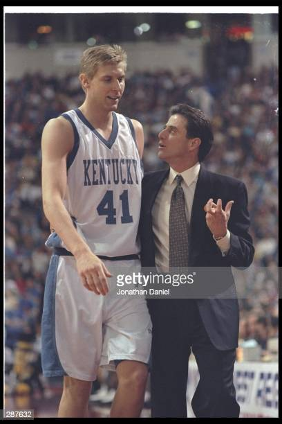 Head coach Rick Pitino of the University of Kentucky talks to player Mark Pope of the Kentucky Wildcats during their 83-63 victory over Wake Forest...