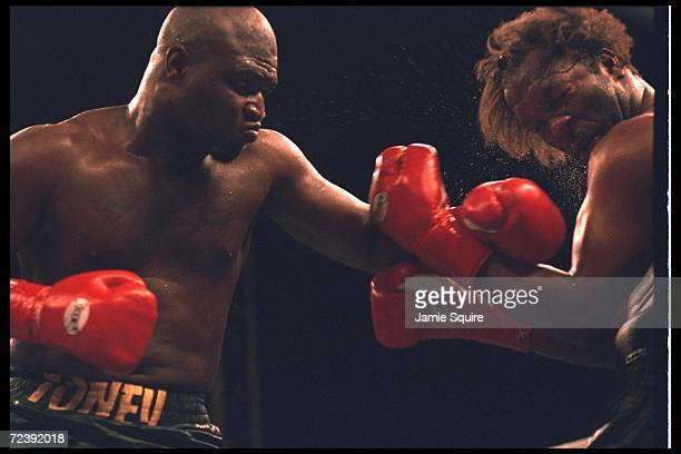 James Toney hammers Richard Mason during a bout in California  Toney