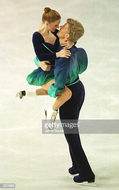 Jenni Meno and Todd Sand of the USA embrace during the pairs performance at the World Figure Skating Championships in Edmonton Alberta Canada The...