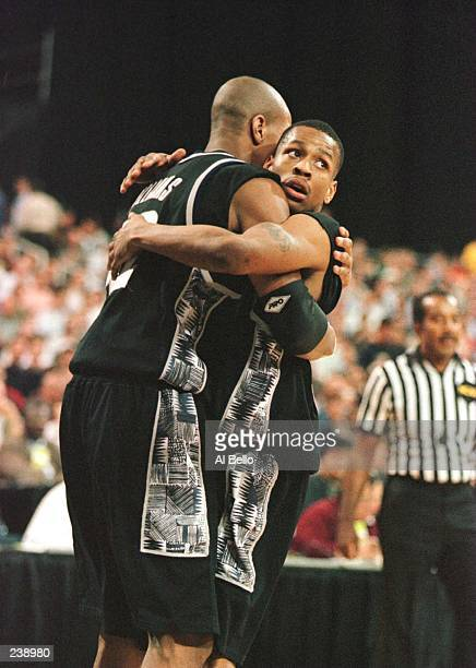 Jerome Williams of the Georgetown Hoyas congratulates teammate Allen Iverson during the first half of the Hoyas 8662 NCAA Eeast Regional Championship...