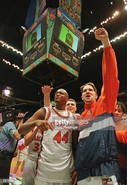 John Wallace and Jim Hayes of the Syracuse Oranagemen celebrate at center court following Syracuse''s 7769 NCAA Final Four Semifinal victory over the...