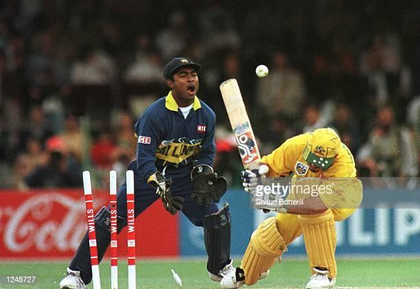Kaluwitharana of Sri Lanka celebrates as Ricky Ponting of Australia is bowled during the Cricket World Cup Final between Australia and Sri Lanka...