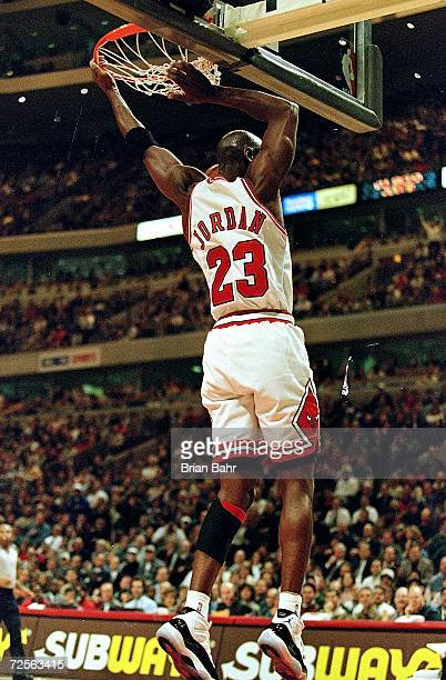 Michael Jordan of the Chicago Bulls dunks the ball during the game against the Detroit Pistons at the United Center in Chicago Illinois The Bulls...
