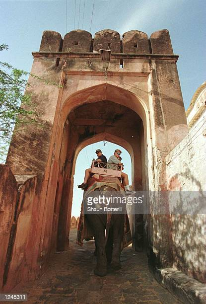 Michael Slater and Shane lee of Australia ride an elephant through a gateway on their way to the Amber Fort in Jaipur Mandatory Credit Shaun...