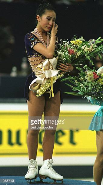 Michelle Kwan of the USA wipes a tear from her eye during the playing of the national anthem following her free skate performance that earned her the...