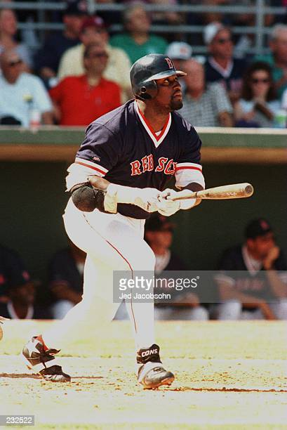 Mo Vaughn of the Boston Red Sox, last years MVP, watches a solo homerun clear the fences during the training game against the Baltimore Orioles in...
