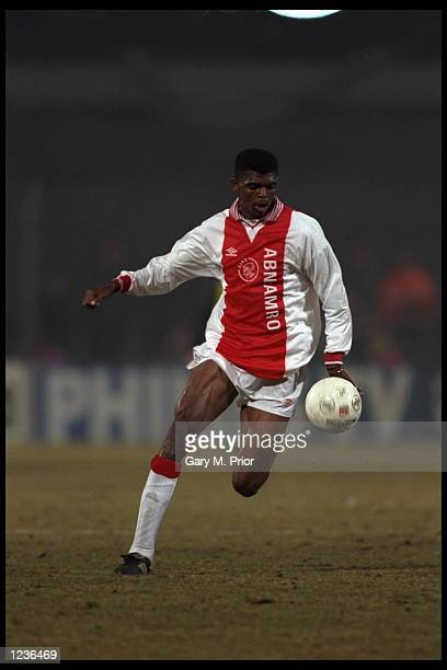 Nwankuo Kanu of Ajax of Amsterdam holds of the challenge during the Champions League match against Borussia Dortmund