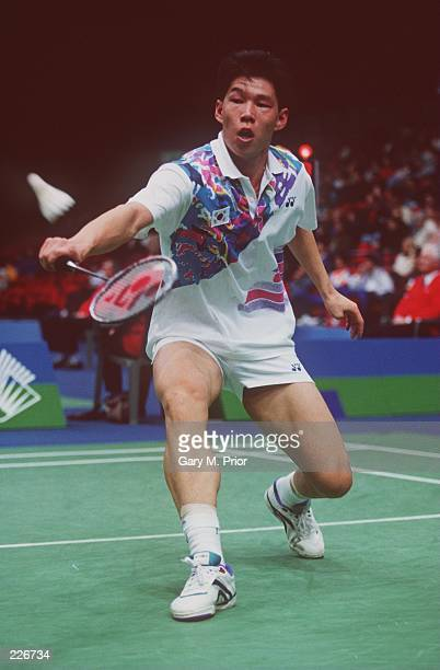 Park SungWoo of South Korea focuses on the badminton as he lunges with a back hand return during a match in the 1996 Yonex AllEngland Championships...