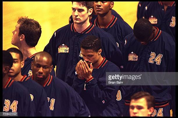 Point guard Mahmoud AbdulRauf of the Denver Nuggets stands in prayer during the singing of the National Anthem before the Nuggets game against the...