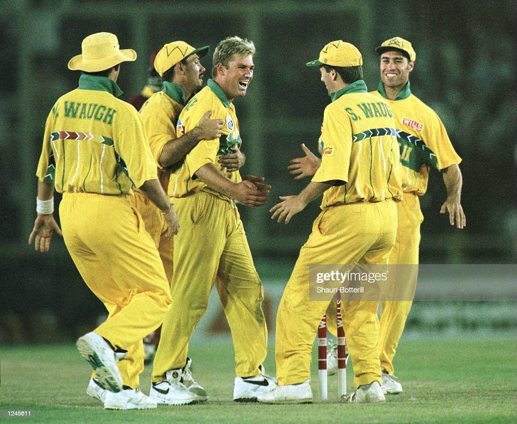 Shane Warne of Australia is congratulated by teammates after taking the wicket of Courtney Brown during the Semi Final match between Australia and...