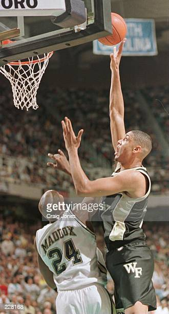 Tim Duncan of Wake Forest makes the shot over Michael Maddox of Georgia Tech during Wake Forest''s 7574 ACC Championship win at the Greensboro...
