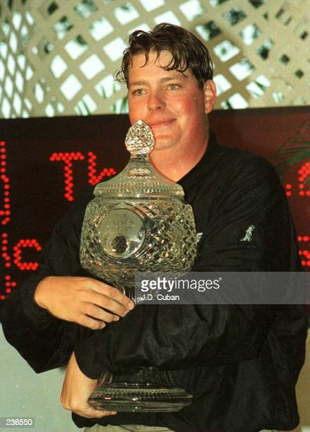 Tim Herron holds the winner''s trophy after capturing the 1996 Honda Classic at TPC at Eagle Trace, in Coral Springs, Florida. Herron fired a final...