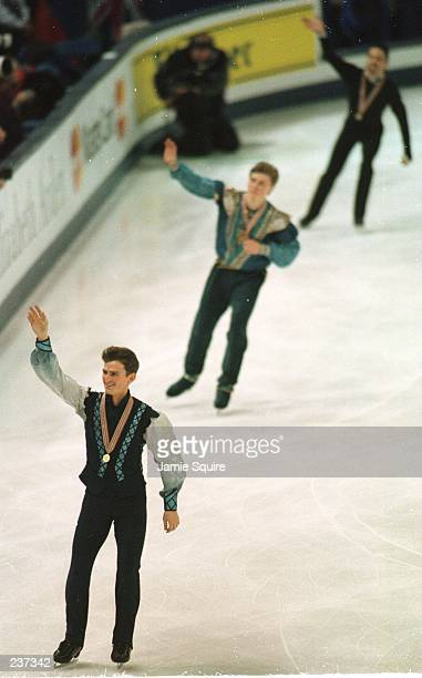 Todd Eldredge of the USA Ilia Kulik of Russia and Rudy Galindo of the USA skate a victory lap after the Men''s Free portion of the World Figure...