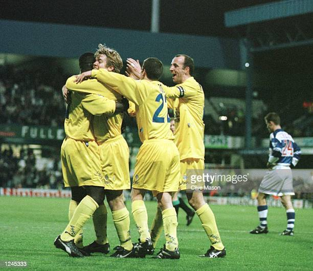 Tony Yeboah is congratulated by his teammates after scoring the opening goal for Leeds United during the FA Premiership game against the Queens Park...