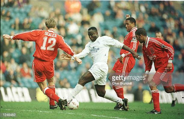Tony Yeboah of Leeds takes on the Liverpool defence during the Leeds United v Liverpool FA Cup Quarter Final match at Elland Road Leeds Mandatory...