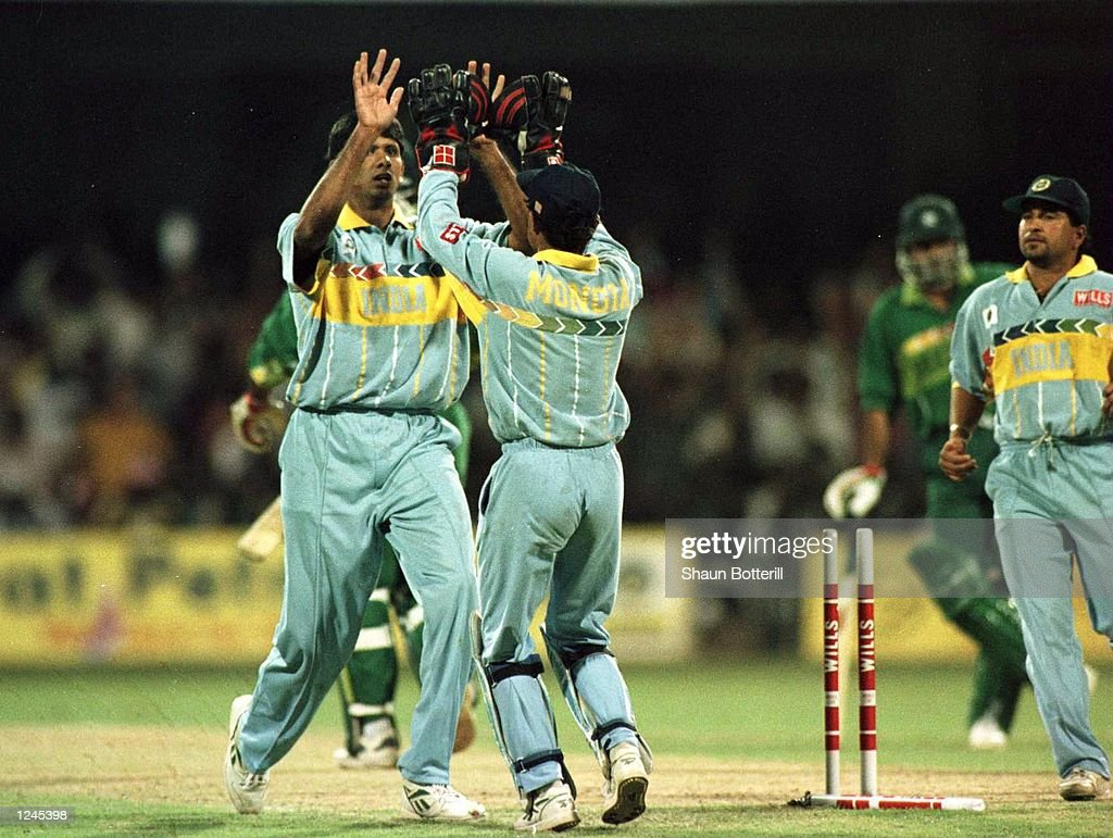 Venkatesh Prasad of India celebrates with Nayan Mongia after taking the wicket of Aamir Sohail during the match between India and Pakistan played in Bangalore, India. Mandatory Credit: Shaun Botterill/ALLSPORT