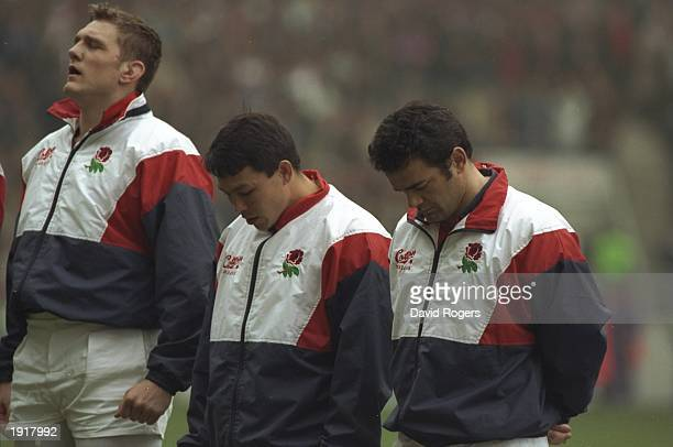 Will Carling and Rory Underwood of England bow their heads during the silence in memory of the victims of the Dunblane massacre before the 1996 Five...