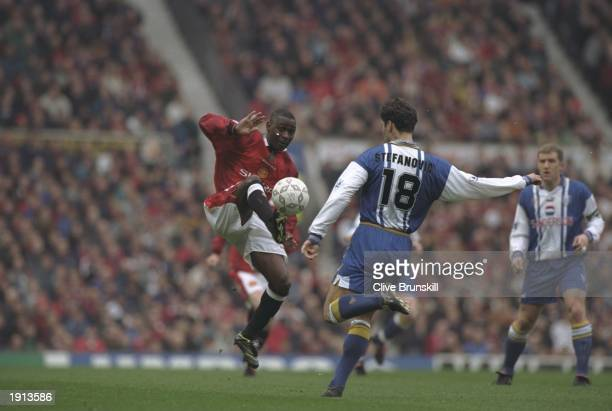 Andy Cole of Manchester United challenges Dejan Stefanovic of Sheffield Wednesday during the FA Premiership match at Old Trafford, Manchester. United...
