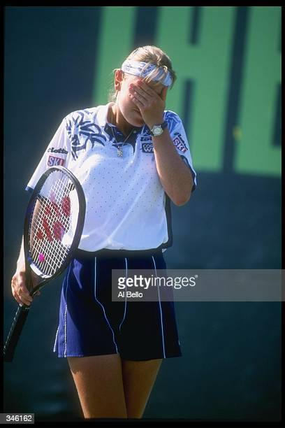 Anke Huber of Germany wipes her face after defeating Lori McNeil of the USA at the Lipton Tennis Championships in Key Biscayne Florida Mandatory...