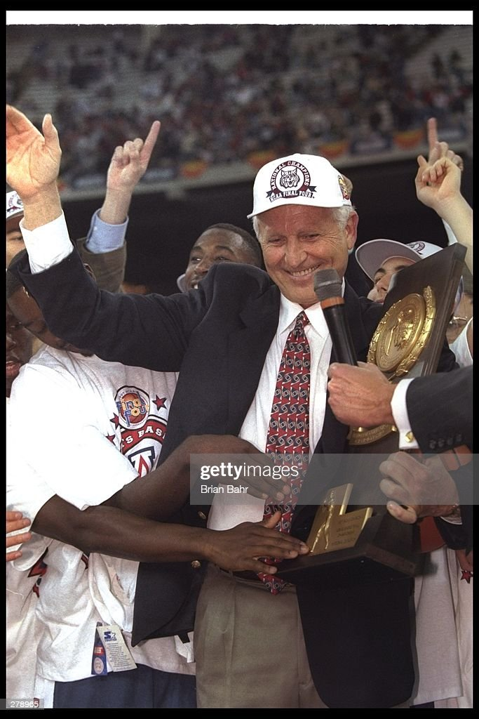 Arizona Wildcats head coach Lute Olson celebrates after a championship game against the Kentucky Wildcats at the RCA Dome in Indianapolis, Indiana. Arizona won the game, 84-79. Mandatory Credit: Brian Bahr /Allsport
