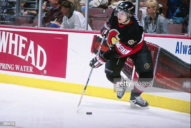 Center Alexandre Daigle of the Ottawa Senators moves the puck during a game against the Anaheim Mighty Ducks at Arrowhead Pond in Anaheim,...